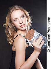 portrait of beautiful young woman with a chocolate
