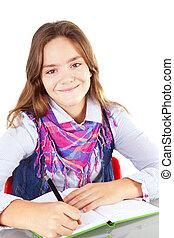 girl writing homework isolated over white