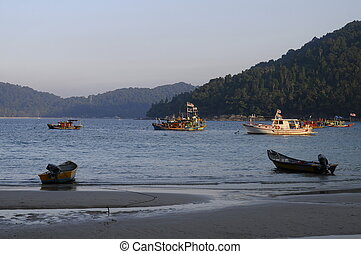 Sea and fishing Boats on sand beach in Malaysia - Sea and...