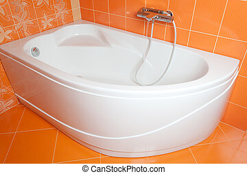 Bath tub in new orange bathroom