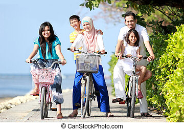 happy family with kids riding bikes