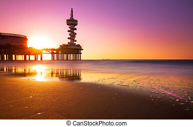 Pink surf sunset - Pink sunset at the surf of Scheveningen,...