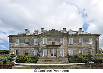 English Country House - The elegant frontage of an...