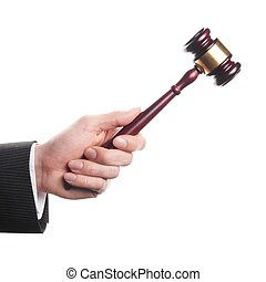 auctioneer - an auctioneer's hand is holding a wooden gavel