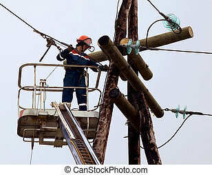 Electrician connects wires on the power line - Electric is...