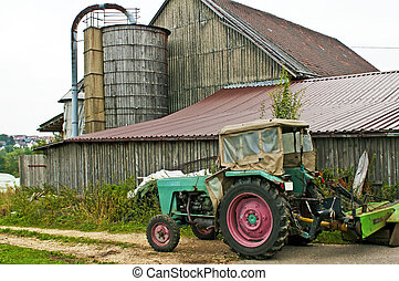 old barn with silo and tractor