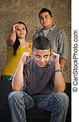 Problem Child Plugging His Ears - Frustrated parents and...