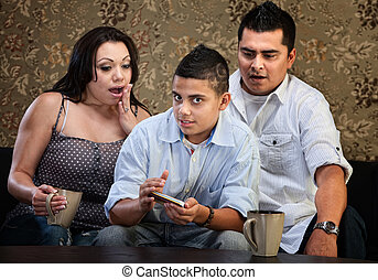 Shocked Parents and Texting Teen