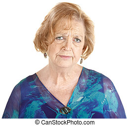 Sad Mature Woman - Sad elderly European woman in blue over...