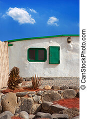 Lanzarote typical white house in costa Papagayo Canary...