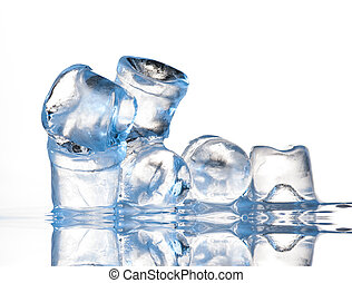 Several ice cubes on glass table. Isolated on white