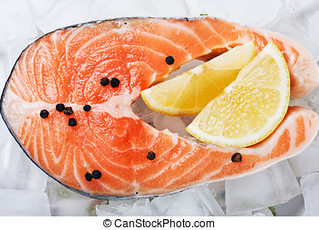 salmon steak with slices of lemon