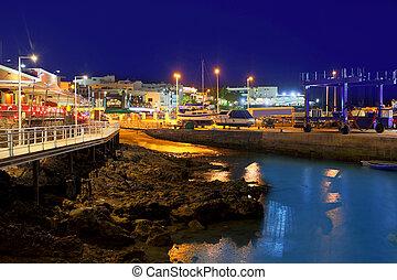 Lanzarote Puerto del Carmen harbour night view in Canary...