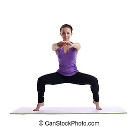 young brunette woman posing in yoga on rubber mat - happy...