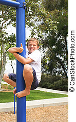 Boy on pole with thumbs up sign