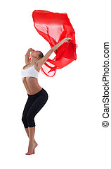 Young blond woman dance with red flying fabric isolated