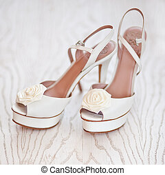 Bridal Shoes on a white wood background