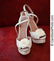 Bridal Shoes on a red background