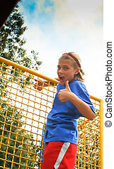Confident preteen female in park
