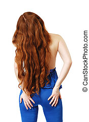 Young woman with long red hair waved - Red-haired woman is...
