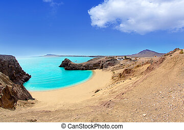 Lanzarote Papagayo turquoise beach and Ajaches in Canary...