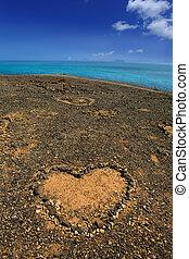 Lanzarote Papagayo and stones heart with Fuerteventura far...
