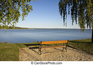 Beach of Balatonkenese with a bench
