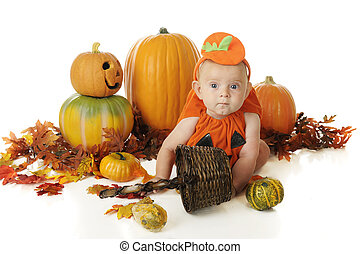 Baby Surrounded by Pumpkins - An adorable baby in a pumkin...