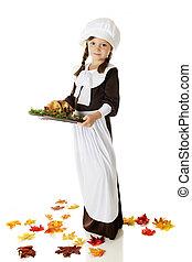 Pilgrim Serving Thanksgiving Dinner - Full-length image of...