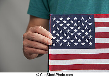 Man Holds American Flag