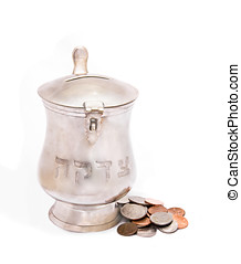 Silver tzedakah, or charity box with coins - Silver...