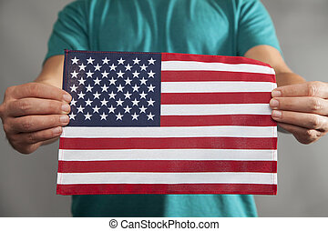 Two Hands Holding Flag