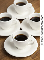 Coffee cups - Four white coffee cups on the table