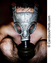 Nude man with gas mask in a black background - Nude man with...