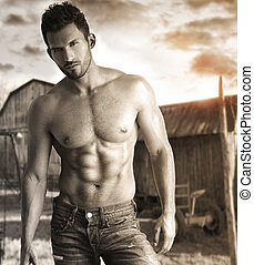 Hunk - Sepia toned portrait of a hunky male model in...