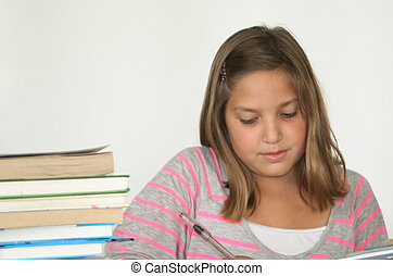 Pretty preteen student studying
