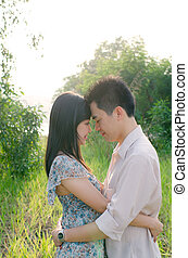 asian outdoor couple during a beautiful sunset