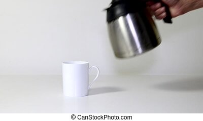 Pouring coffee - Manu2019s arm ,placing a mug on a table,...