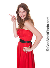 Woman in red dress pointing