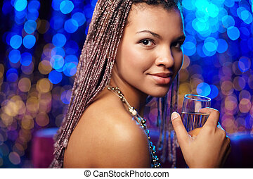 Girl wih champagne - Portrait of a beautiful ethnic woman...