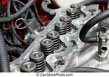 Car servicing - Repairing of modern gasoline engine closeup...