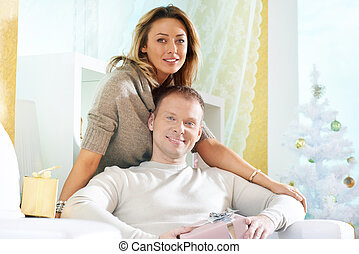 Christmas day - Happy woman and her husband having rest at...