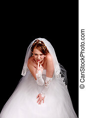 Redhead bride in a white dress with a black background
