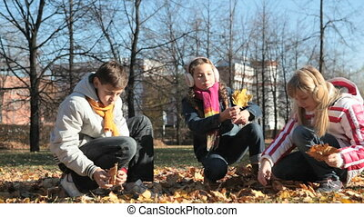 Maple gold - Lovely children picking golden maple leaves...
