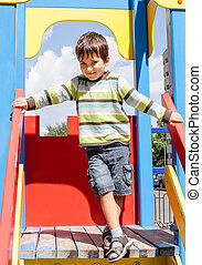 playground - cute boy standing on playground