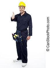 Industrial contractor gesturing thumbs up