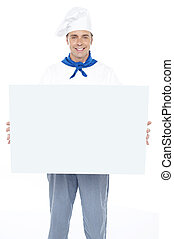 Handsome male chef holding ad board isolated over white...
