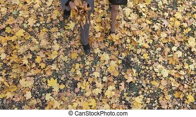 Autumn spirit - Close-up of a smiling couple throwing fallen...