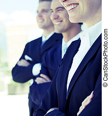 friendly business team - three businesspeople standing and...