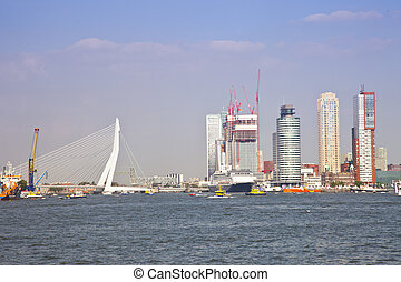 Skyline with water of Dutch city Rotterdam with buildings...